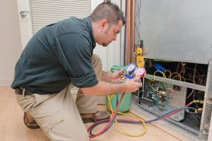 air conditioning repair worker